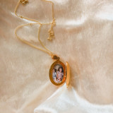 Gold Oval Locket with Photo of Two Children Inside