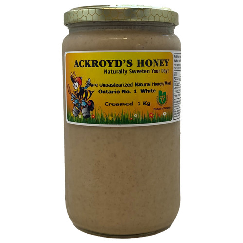 1Kg of 100% Pure Unpasteurized Natural Ontario #1 White Creamed Honey with cinnamon in a glass jar.