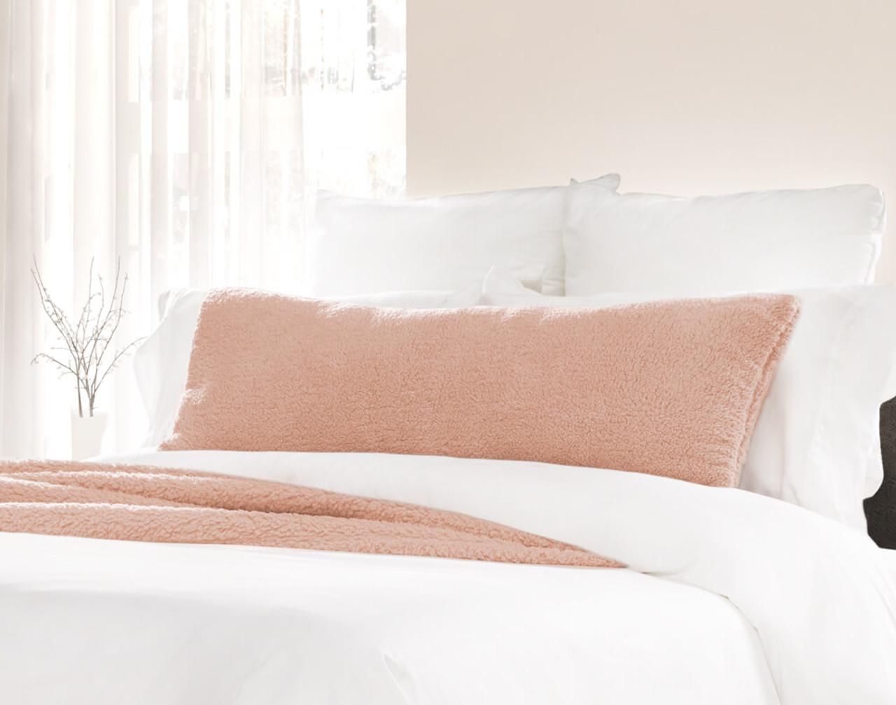 Teddy Lumbar Pillow in Dusty Peach, a light pink.