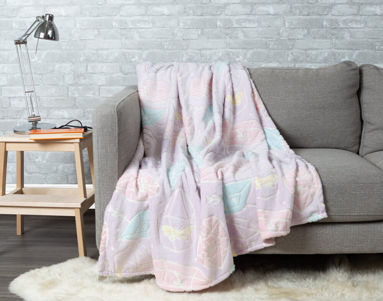 Crystal Glow in the Dark Throw pictured draped over a couch.