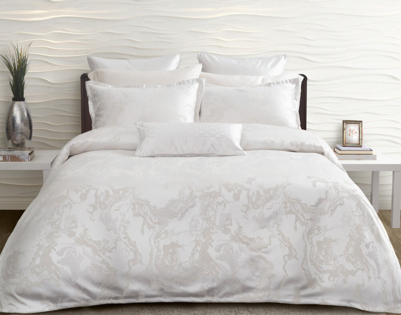 Travertine Bedding Collection features a stone-inspired jacquard in soft white, silver, and cream, and is finished with a 1-inch flange.