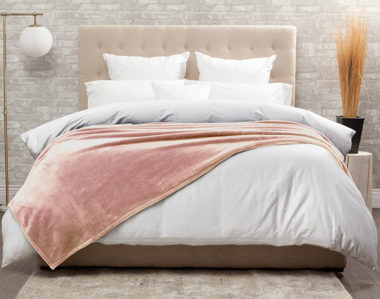 The Cashmere Touch Fleece Blanket pictured in Rose Smoke, a pale pastel pink.