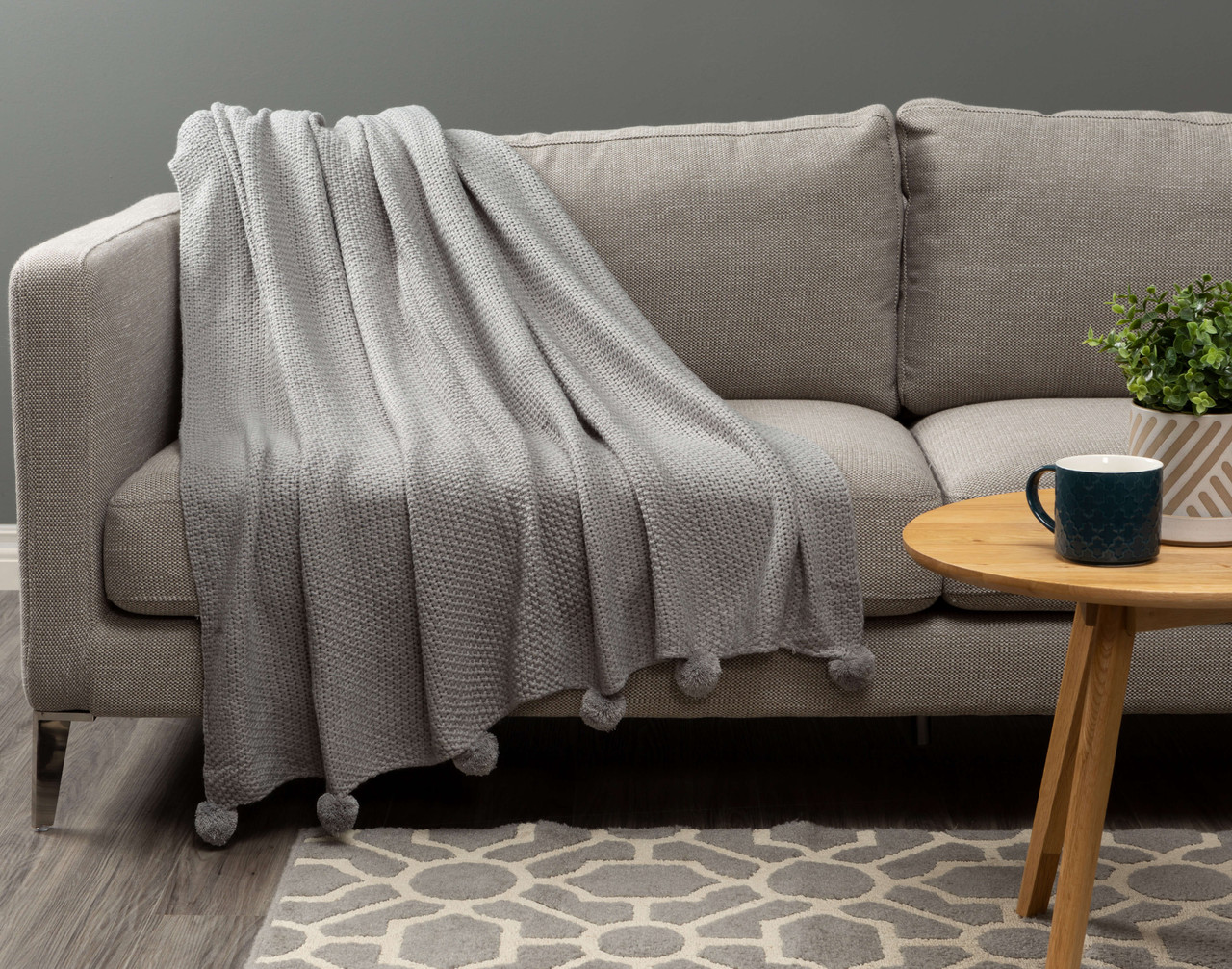 Pom-Pom Knit Throw in Sleet, a soft grey.