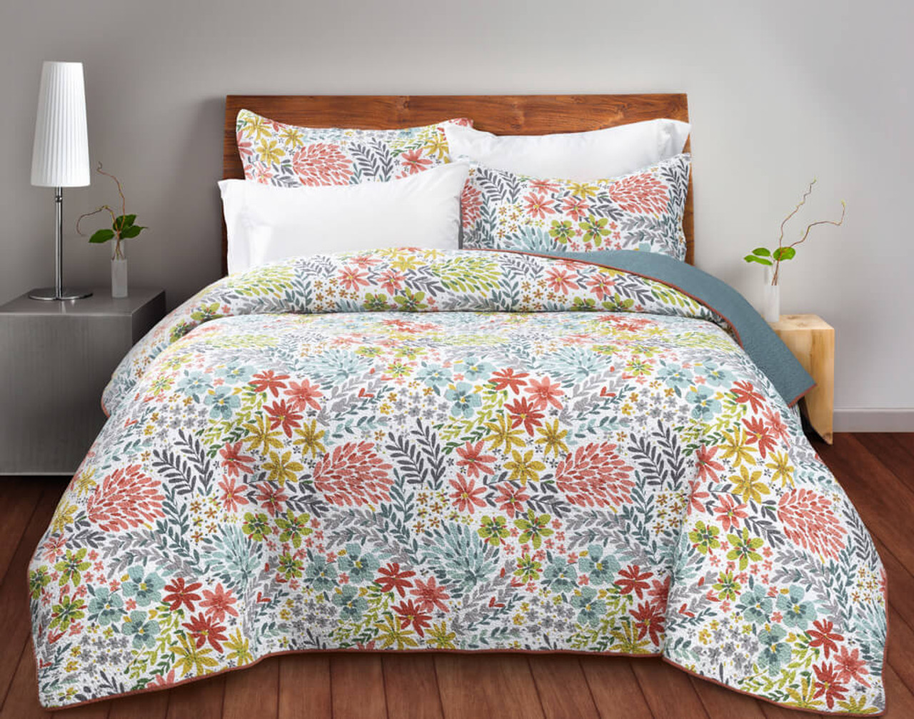 Camrose Cotton Quilt Set, featuring vibrant botanicals in shades of terracotta, lime green, grey and pink on a white background.