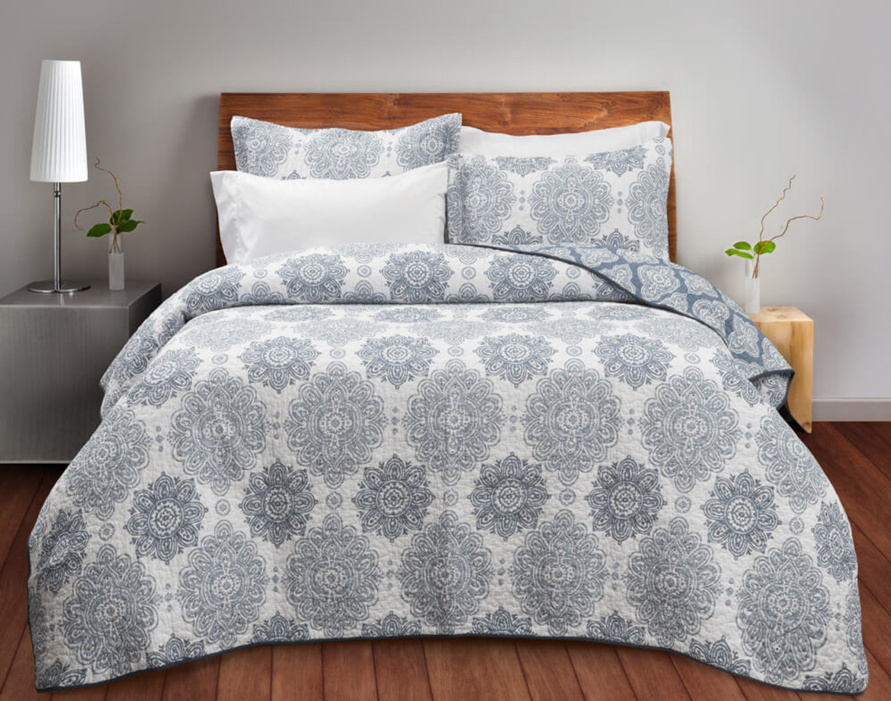 This muted blue-grey reversible medallion print brings a boho ambience to any bedroom.