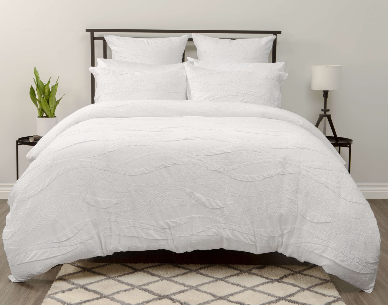 Anira features etched tribal leaves woven in a raised matelassé pattern in white.