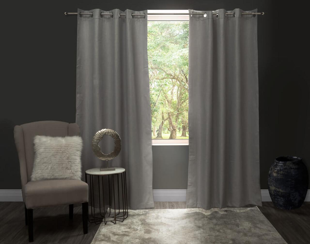 Linen Look Blackout Drapery Panel in Silver against window.