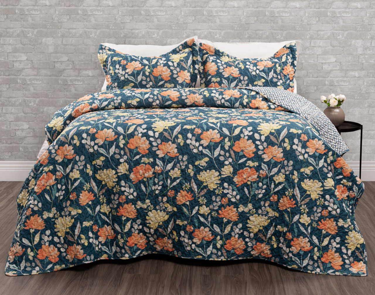 Ladysmith Coverlet Set, featuring bright yellow and orange florals on a petrol blue background.