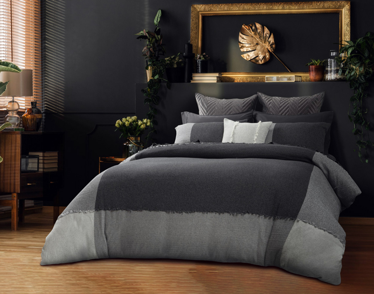 Angled view of Thoren Bedding Collection, featuring the Thoren Duvet Cover, Thoren Pillow Shams, and Thoren Square Cushion Cover