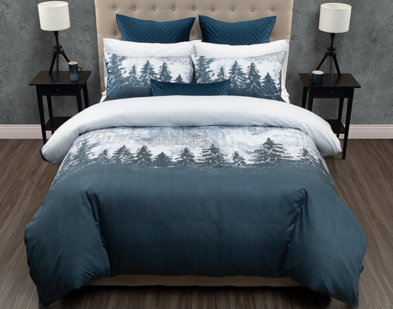 Front view of our Alps Duvet Cover and Pillow Shams, featuring a dark and snowy forest design.