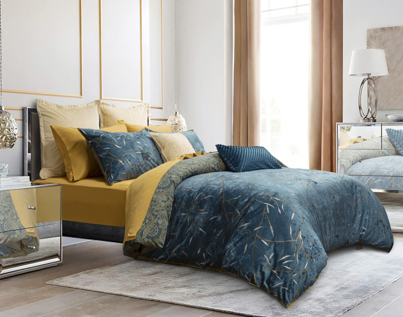 Side view of the Charisma Duvet Cover with bright Honey Gold sheeting underneath.