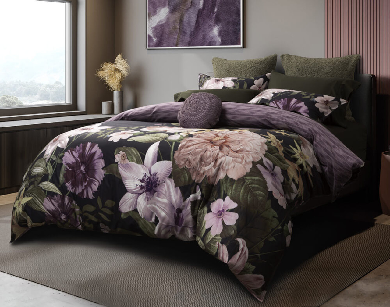 Our Greta Floral Duvet Cover features dark purples and rainforest greens on a deep black background.
