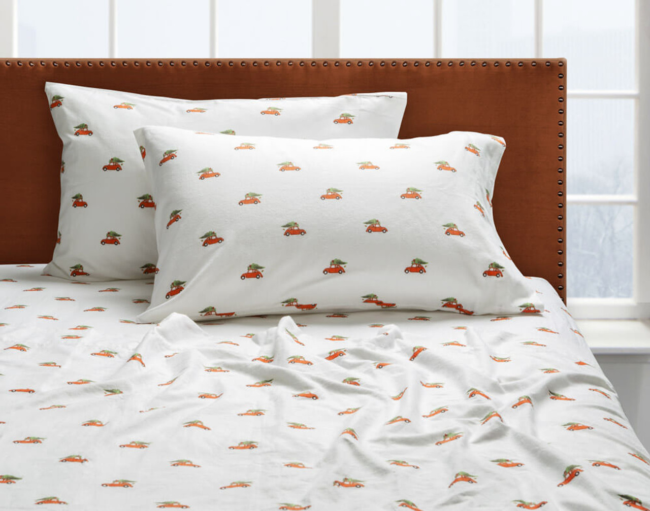 Our Flannel Cotton Sheet Set in Festive Ride dressed over a twin bed.