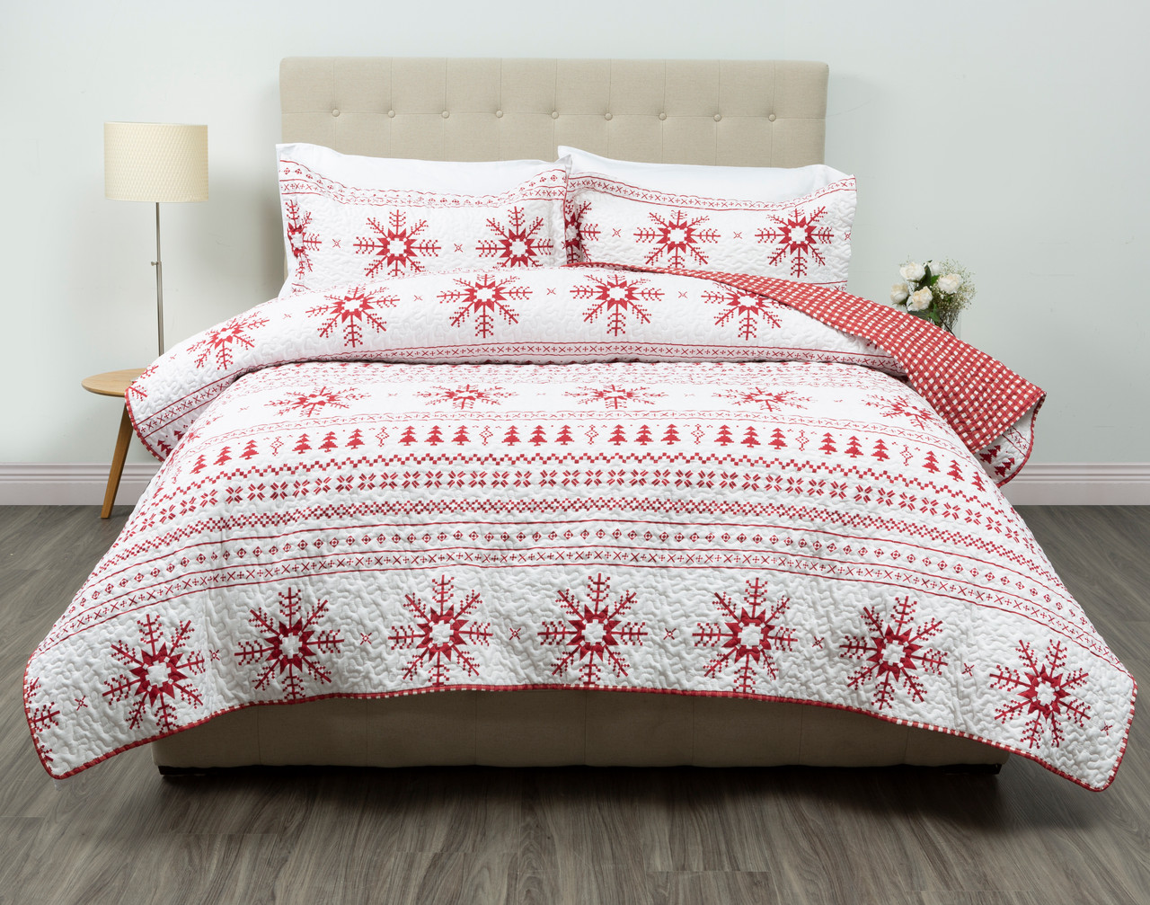 Yuletidings Coverlet Set, featuring red snowflakes and trees with a solid background in white.
