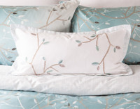 Hazelwood Boudoir Cushion Cover features satin-stitched embroidery.