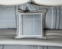 Renzo Square Cushion Cover on bed
