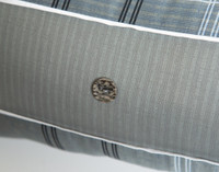 Close up of button detailing on Renzo Boudoir Cushion Cover.