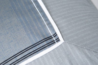 Close up of pinstripe detailing on Renzo accessory cushion covers.