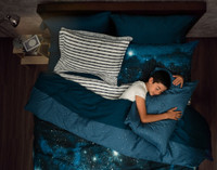 Supernova Duvet Cover with boy sleeping