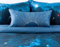 Supernova Boudoir Cushion Cover on bed