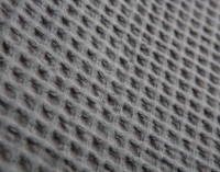 Side view of Cotton Waffle Blanket in Charcoal.