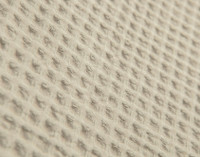 Close-up view of Cotton Waffle Blanket in Oatmeal texture.