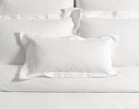 Astoria White Boudoir Cushion Cover with two inch flange on bed