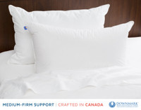 Firma Down Pillows on bed