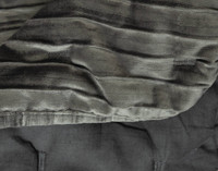Close-up view of Cavalo Quilt Set in Charcoal corner fabric texture.