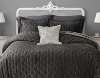 Cavalo Quilt Set in Charcoal is a dark grey with a vertical ripple quilt pattern.