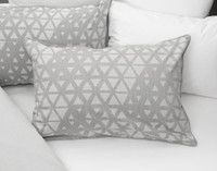 Theo Pillow Sham on bed