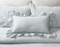 Barcelona Boudoir Cushion on bed