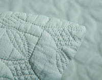 Close-up view of Riverglade Sand Washed pillow sham in Bluette corner.