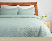 Riverglade Sand Washed Coverlet Set in Bluette is a light mint green with a leaf quilt design.