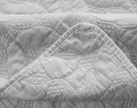 Close-up view of Riverglade Sand Washed pillow Sham in Silver corner.