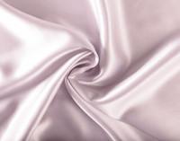 100% Mulberry Silk Pillowcase in Lavender Purple fabric close-up.