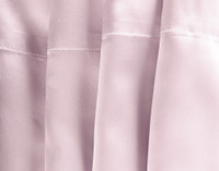 100% Mulberry Silk Pillowcase in Lavender Purple seam close-up.