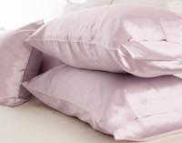 100% Mulberry Silk Pillowcases in Lavender Purple stacked.