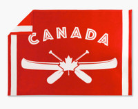 The Canoe Canada Fleece Throw is a bright red throw with white designs and writing.
