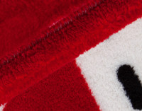 Close-up view of corner of Canada Fleece Throw.