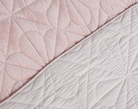 Close up of pattern for Daisy Cotton Quilt Set,  pink velvet finish contrasted with reverse in a soft cotton light pink