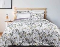 A subtle, sophisticated update for any bedroom, Avignon features teal and purple florals on a white backdrop.