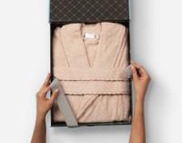 Cotton Bathrobe in Blush, nestled in a gift box.