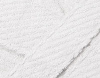 Close up of texture on Cotton Bathrobe in White.