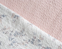 Side by side comparison of the Annalise Cotton quilt set white and botanical print and reverse light pink print.