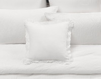 Palma Square Cushion Cover features a slubbed white cotton/linen blend fabric and features a 2-inch scalloped eyelet flange.