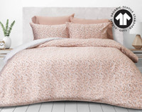 300TC Organic Cotton Duvet Cover Set in Maisel features a lively floral pattern with pinks and whites.