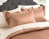 Close up angle view of pillows and duvet cover.