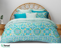 Mombasa Duvet Cover featuring a medallion print in turquoise, blue, and yellow.