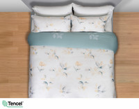 Repose Duvet Cover featuring teal and yellow leaves on a white background, seen from above.